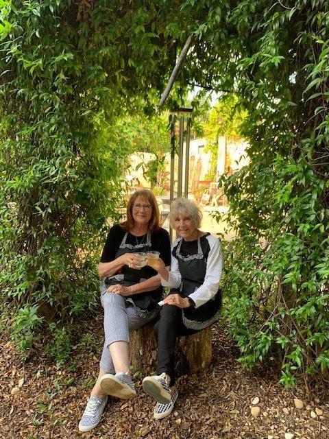 Pamela and Lindalee sitting outside